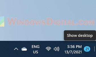 Hover or click on the far corner of taskbar to show the desktop Windows 11